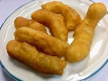 Petisco e sobremesa fritados quentes do doughstick Ideia superior do chinês imagem de stock