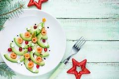 Petisco saudável do aperitivo do Natal - arando salmon Chr do abacate Foto de Stock Royalty Free