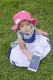 Petit amour de bébé pour jouer la technologie Image stock