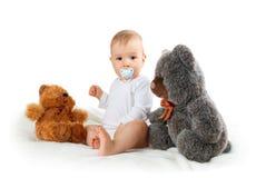 Petit bébé d'isolement sur le fond blanc avec Photo stock