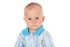 Petit bébé garçon sérieux photo libre de droits