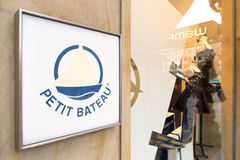Petit Bateau. Sign infront of a Petit Bateau store with copy space to the right Royalty Free Stock Photos