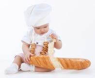 Petit boulanger interrompant le morceau de pain Image libre de droits