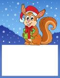 Petit cadre avec l'écureuil de Noël Photographie stock libre de droits
