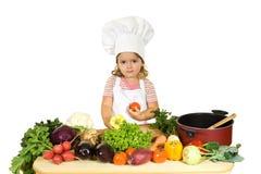 Petit chef avec des légumes Photo libre de droits