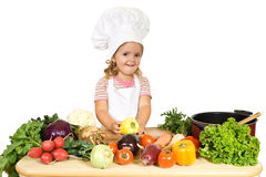 Petit chef heureux avec des légumes images stock