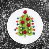 Petit déjeuner sain de casse-croûte de dessert de Noël pour des enfants photographie stock