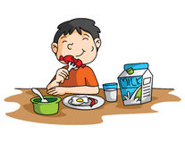 Petit déjeuner de garçon Photos libres de droits