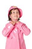 Petit enfant avec l'imperméable photographie stock