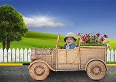 Petit enfant sur une voiture de jouet Photos stock