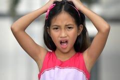 Petit Filipina Juvenile soumis à une contrainte image stock