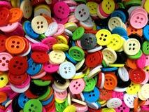 Petit fond de couture désordonné coloré de boutons images libres de droits