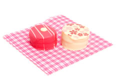 Petit four on napkin Stock Images