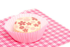 Petit four on napkin Royalty Free Stock Photos