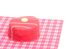 Petit four on napkin Royalty Free Stock Images