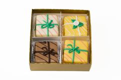 Petit fours. An assortment of petit fours in a gold box Royalty Free Stock Photos