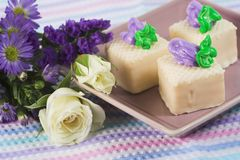Petit fours. Three petit fours with flower decor Royalty Free Stock Image