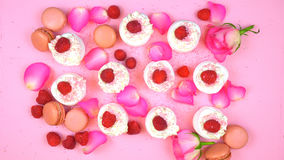 Petit Fours presentation of macarons with berries and rose petal Royalty Free Stock Photo
