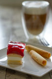 Petit Fours with Strawberries. On a plate Stock Photography