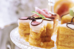 Petit fours on tray Royalty Free Stock Photos