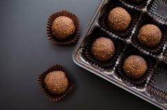 Petit fyra sötsaker för choklad i omslag Royaltyfria Foton
