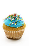 Petit gâteau avec de la crème bleue Images libres de droits