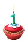Petit gâteau avec le numéro un sur le blanc Image stock