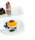 Petit gâteau crème de myrtille Photos libres de droits