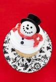 Petit gâteau de bonhomme de neige Images libres de droits