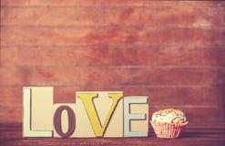 Petit gâteau et amour de mot Images libres de droits