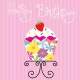 Petit gâteau mignon avec des fleurs sur la conception de tasse Image stock