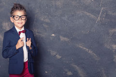 Petit garçon élégant dans le costume Images stock