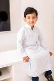Petit garçon Arabe TV Photographie stock libre de droits