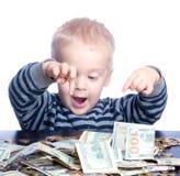 Petit garçon avec l'argent Photo libre de droits