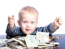 Petit garçon avec l'argent Photo stock