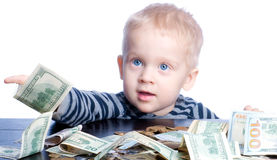 Petit garçon avec l'argent Photographie stock