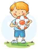 Petit garçon avec la bille du football Images libres de droits