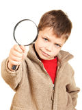 Petit garçon avec la loupe Photographie stock