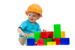 Petit garçon avec le casque antichoc et les modules  Photographie stock libre de droits