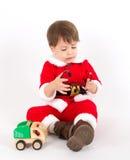 Petit garçon avec le costume de Santa Photos stock