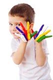 Petit garçon avec les mains peintes Photographie stock libre de droits