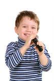 Petit garçon avec un microphone Photos stock