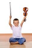 Petit garçon avec un violon photo stock