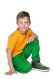 Petit garçon blond de sourire photographie stock libre de droits