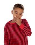 Petit garçon couvrant sa bouche photos libres de droits