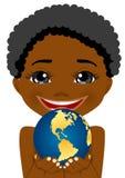 Petit garçon d'afro-américain tenant le globe de la terre Images stock