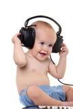 Petit garçon dans des écouteurs Photos libres de droits