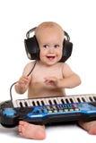 Petit garçon dans des écouteurs Images libres de droits