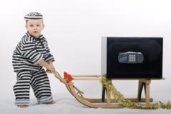 Petit garçon dans l'équipement de voleur Image libre de droits