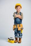 Petit garçon dans la ceinture d'outil photos libres de droits